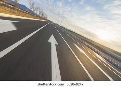Sunset arrows road