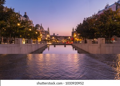 Sunset at an artificial reservoir on the Avenue of the Allies (Avenida dos Aliados) in Porto, Portugal. Porto is one of the most popular tourist destinations in Europe.