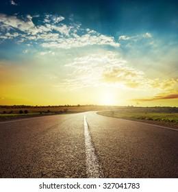 sunset and asphalt road