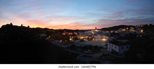 Sunset in autumn in Sanlúcar de Guadiana and Alcoutim, border between Spain and Portugal. Small towns illuminated in the evening.