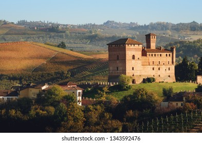 Sunset in autumn, during harvest time, in the landscape and vineyards near the castle of Grinzane Cavour, in the Langhe region, one of the most importan wine districts of Italy