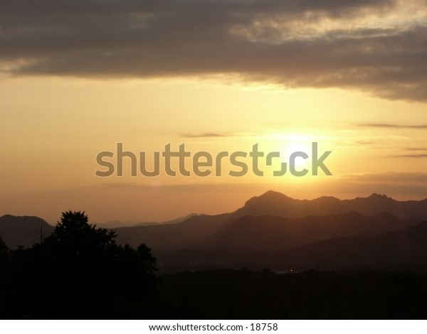 Sunset in autumn from a hill top