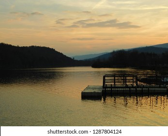 Sunset autumn view of lake.  Photo taken at Aitch Boat Launch, Raystown Lake Region, Pennsylvania.  Appalachian mountains in the background.