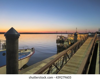 Sunset in Ayamonte, Andalucia, taken from a berth in the town looking along the Guadiana River to the International bridge linking Spain and Portugal.