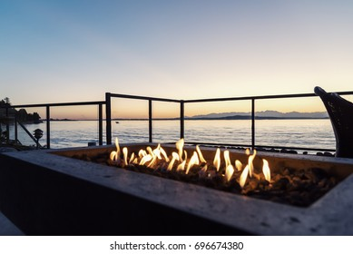 Sunset in the backyard by the fire pit and the sea.