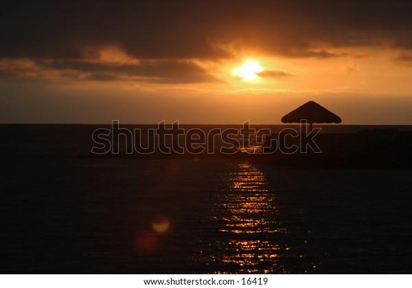 Sunset in Baja with umbrella sillouhette