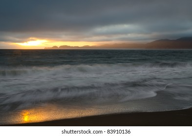 Sunset at Baker Beach with Marin Headlands in the background
