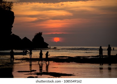 Sunset in Bali. Photo taken on Pandang-Pandang Beach. Image includes silhouettes of people