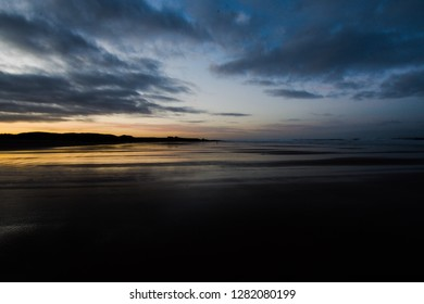 Sunset at Bamburgh Beach on a cool winters evening, Northumberland, England, United Kingdom (2019)