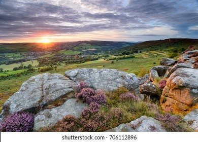 Sunset from Baslow Edge in the Derbyshire Peak District, looking out to Curbar village with Curbar Edge in the far right