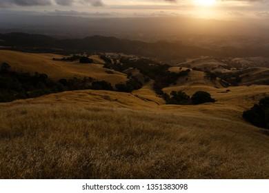 Sunset bathes hills in golden light at Mt Diablo in California