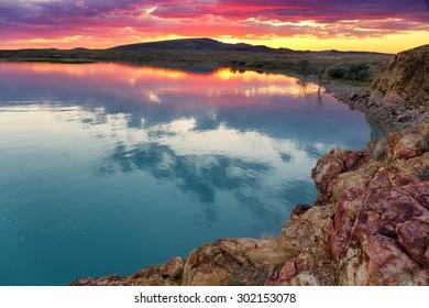 Sunset in the bay on the north shore of Lake Balkhash, Kazakhstan