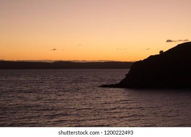 Sunset at the bay on Waiheke Island, Auckland, New Zealand