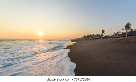Sunset at Beach with Black Sand in Monterrico, Guatemala. Monterrico is situated on the Pacific coast in the department of Santa Rosa.