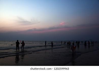 sunset at the beach with blue and orange hues (juhu beach mumbai)