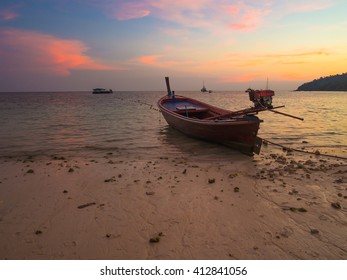 Sunset beach with the boat,Emerald sea,Traveling long boat,scuba boat,summer at Andaman sea,Colorful sky in twilight,Lipe island,Koh Lipe Stul Thailand. - Shutterstock ID 412841056