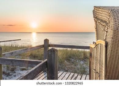 Sunset and beach chair at the Baltic Sea Beach
