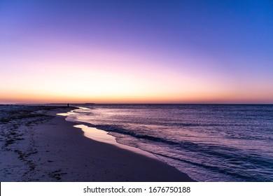 Sunset at the beach. Editing space. blue hour: blue, purple, yellow, orange colors. No people. Jurien bay near Perth, Western Australia WA, Australia, west coast