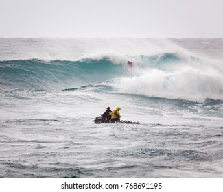 SUNSET BEACH, HAWAII, USA - DECEMBER 2: Surf patrol in front of massive wave break at the 2017 Vans World Cup of Surfing competition at Sunset Beach on Oahu's scenic North Shore.