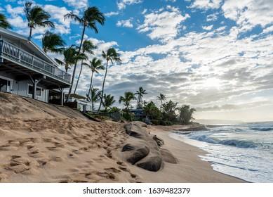 Sunset Beach, Hawaii/USA- Jan 1, 2020: Loss of yards and homes due to beach erosion on Sunset Beach, Oahu, Hawaii