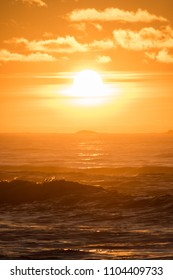 Sunset Hellstø beach with lighthouse yellow red Norway 6