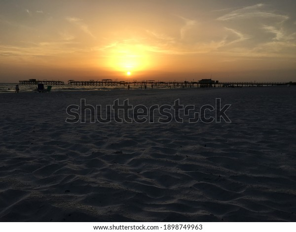 Sunset Beach with a pier and an amazing sky