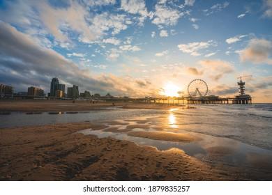 Sunset at the beach, Pier of scheveningen, The Hague, Netherlands.