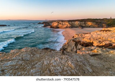 Sunset in beach with rocks in Porto Covo in Alentejo, Portugal.