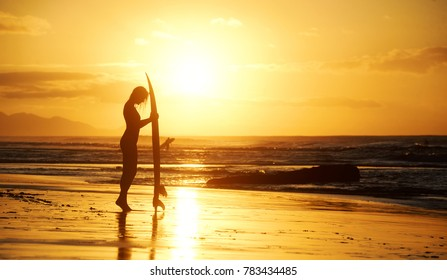 Sunset beach session with a surfer girl on Fuerteventura