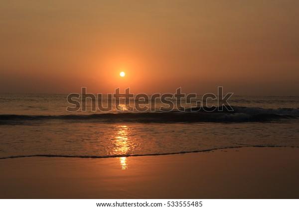 sunset beach in a winter evening