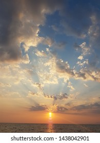 sunset beams clouds sun blue and orange golden summer  colors greece