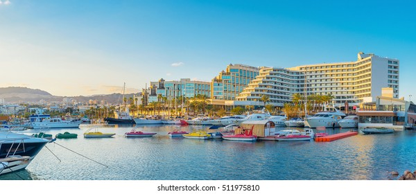 The sunset beams and various colorful boats and yachts make marina of Eilat one of the most beautiful locations in resort, Israel.