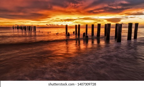 Sunset beautiful beach with an old pier in Florida, Naples