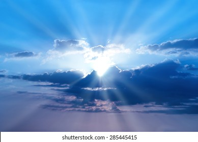 Sunset is beautiful blue sky with sunbeams and clouds
