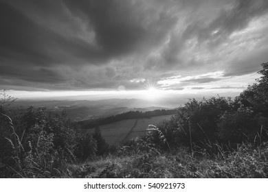 Sunset with beautiful clouds over a rural Oregon countryside. Black and white.