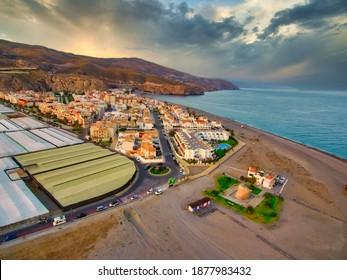 Sunset in beautiful coastal village. Aerial Drone Photo