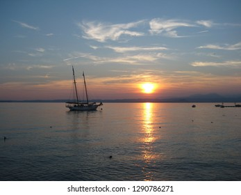 Sunset at the beautiful Garda lake (Lago Di Garda) in Italy. A view from the town of Lazise.