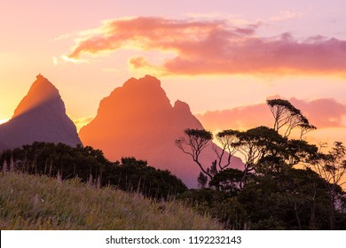 Sunset beautiful Mauritius paradise landscape. Mauritius nature view of colorful sky and light of sun. Mountains with trees near Port Louis, Mauritius.