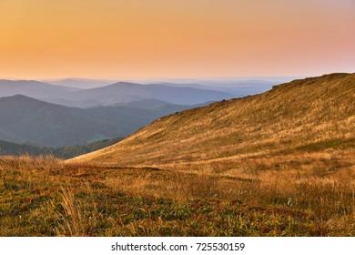 Sunset. Beautiful panoramic view of the Bieszczady mountains in the early autumn, Bieszczady National Park (Polish: Bieszczadzki Park Narodowy), Poland.