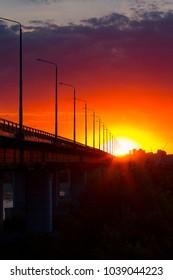 sunset. beautiful sunset in summer. bridge and river at sunset. sunset.