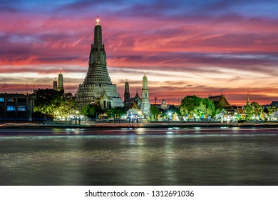 sunset at beautiful temple in Bangkok Thailand near the river