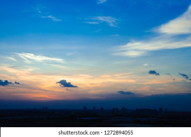 sunset and beautiful twilight fluffy storm cloudy blue and yellow sky smoothly flowing to fantastic mind. Rainny good evening and have a nice day concept.