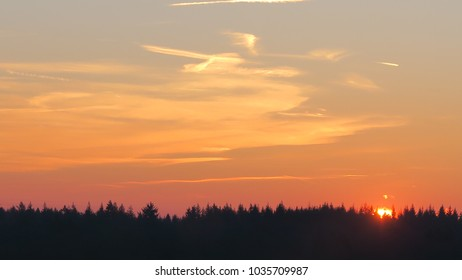 the sunset before its become dawn and the sky become dark. there are bird in the sky
