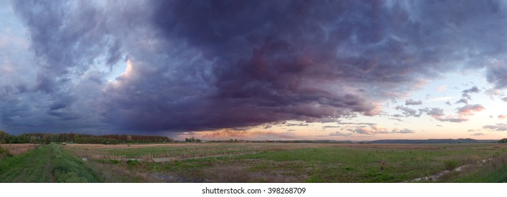 Sunset before storm. The dark clouds before the storm. Purple dramatic sky. Large high resolution panorama merges from 7 vertical photos.