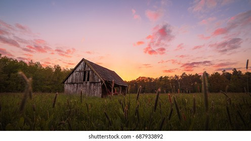 Sunset behind an abandoned barn