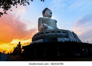 Sunset behind the big Buddha in phuket thailand..
