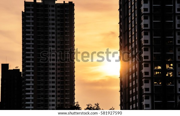 Sunset behind building
