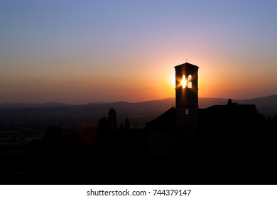 Sunset behind a church bell tower