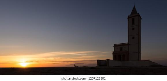 Sunset behind the Church of Las Salinas in Cabo de Gata. Almeria