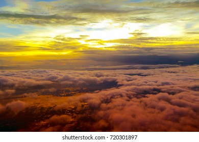 The sunset behind the cloud with the beautiful cloud formation. Aerial View Thailand.